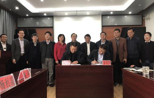 学校与云南省农科院热带亚热带经济作物研究所签订协议